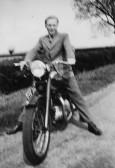 Ivan Martin on a motorbicycle in Pymoor Lane, Pymoor, circa 1951.