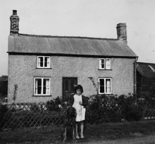 Carol Moxon with 'Rex' outside Dunkirk Cottage, Dunkirk, Pymoor.