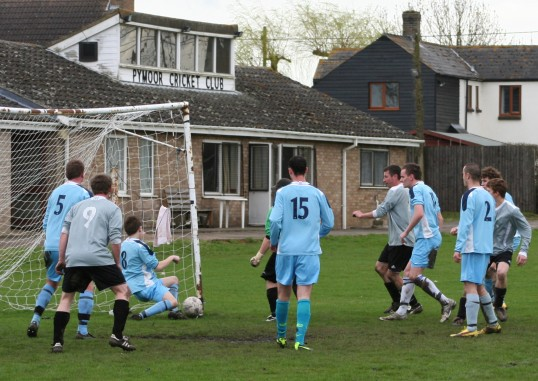 Pymoor FC claimed this ball crossed the Godmanchester Rover's goal line despite the valiant effort of the defender. Not given & Pymoor lost 2-1.