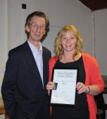 Brian Bacon presents Emma Ure with her Bronze Medal & Certificate in Country & Western Line Dancing in the Pymoor Social Club.