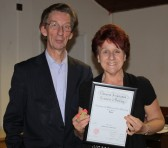 Brian Bacon presents Christine Sabertonwith her Gold Medal & Certificate in Country & Western Line Dancing in the Pymoor Social Club.