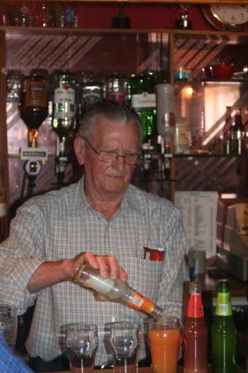 Albert Keys serving drinks in the Pymoor Cricket & Social Club, Pymoor Lane, Pymoor, 2006.