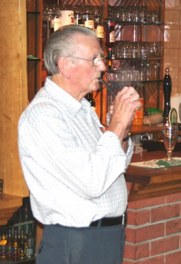 Albert Keys enjoys his pipe in the Pymoor Cricket & Social Club, Pymoor Lane, Pymoor, 2006.
