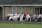 Pymoor CC team members watch the progress of their innings during their season's opening match against Littleport CC.