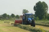 Baling the hay on Graham Lark's field off Pymoor Lane, Pymoor, 2010.