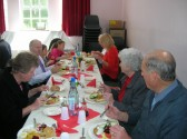 Visitors enjoying the food at the Pymoor & Coveney Methodist Churches D-Day Celebration Tea at the Chapel in Main St. Pymoor 2010.