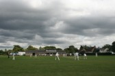 Dark clouds hang over the Pymoor Cricket team during their penultimate match of a challenging season. They were relegated from their league, 2010.