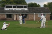 Jack Hargraves takes a diving catch in Pymoor CC's last match of the season against Witcham, 2010.
