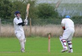 The Witcham CC wicketkeeper takes evasive action as Pymoor CC's Ciaran Russell hits the ball for 4 runs, 2010.
