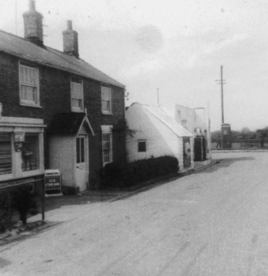 The shop & Garage in Main Street, Pymoor, looking north towards the crossroads.