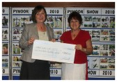 Christine Saberton receives a cheque on behalf of the Pymoor Social Club at the Pymoor Show Charity Cheque Presentation Evening, 2010.