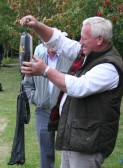 Eric Barker weighing a 'catch' during the Roger Parson Memorial Charity Fishing Match 2009.