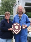 Cynthia Parson presents Tony Rudderham with the winner's Trophy at the Roger Parson Memorial Charity Fishing Match 2010.