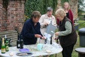 Alocha Barker collects her raffle prize from Cynthia Parson at the Roger Parson Memorial Charity Fishing Match 2009