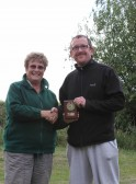 Cynthia Parson presents the 2nd Place Award to Paul Burgess at the Oxlode Lakes Charity Fishing Match, Pymoor 2011.