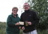 Cynthia Parson presents the 'Biggest Fish' Award to Paul Burgess at the Oxlode Lakes Charity Fishing Match, Pymoor 2011.