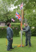 Putting up the Maypole in Joan Saberton's garden in Pymoor Lane, Pymoor, to celebrate HM Queen's Diamond Jubilee 2012.