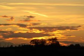 A Fenland sunset seen from Main Drove, Pymoor, 2011.