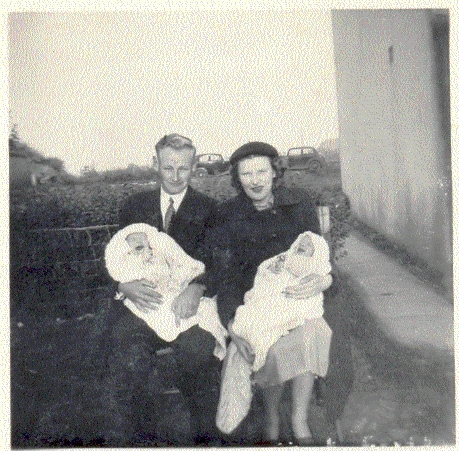 Albert and Mary Heaps at the Christening of their twins Roland and Bruce in Pymoor, 1954