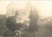 Ena Barker outside the one window cottage, Pymoor, circa 1938