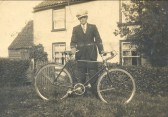 James Rogers about to go for a bicycle ride in Pymoor, circa 1936.