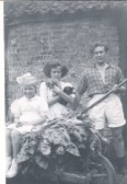 Mary & Sylvia Hannah with John King outside the pig sty at Oxlode Hall, Pymoor.