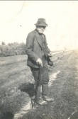 Amos (Tidlum) Lucas, looking across the fields in Pymoor, circa 1922