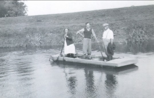 Earnest and Dorothy Pearson with another crossing the 100 Foot River, Pymoor.. The picture shows Ern Pearson's Wife Doll as she use to..