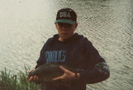 Steve Saberton, with a fish, at Oxlode Fishing Lakes, Oxlode, Pymoor, 1996.