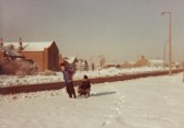 Richard Hodgson pulling Nicholas Saberton on a sledge in Main Street, Pymoor.