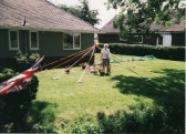 Joan Saberton in her garden with a Maypole at the time of Queen Elizabeth II's Golden Jubilee Celebrations in Pymoor.