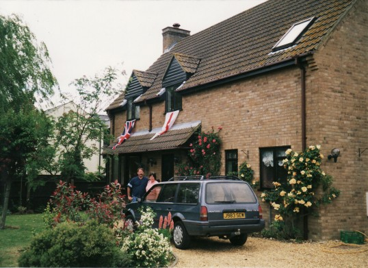 Steve & Julie Knowles outside their home at the time of Queen Elizabeth II's Golden Jubilee Celebrations in Pymoor, 2002.
