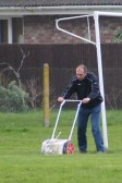 Kevin Jennings painting the lines for a forthcoming football match on the Pymoor Cricket & Social Club field, Pymoor Lane, Pymoor 2011.