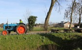 Roger Kent on his tractor in Pymoor Lane, Pymoor.