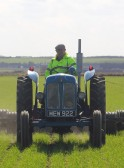 Roger Kent on his tractor, rolling a wheat field off Pymoor Lane, Pymoor.