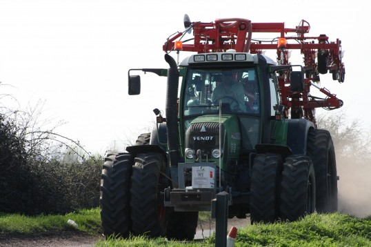 A Fendt tractor on the move along Pymoor Lane, Pymoor, 2011