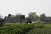 A Fendt tractor on the move along Pymoor Lane, Pymoor.