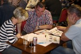 Becky & Mark Taylor & Shaun Butcher ponder on the Table Round questions in Garry Palmer's Charity Quiz at the Pymoor Social Club, Pymoor 2011.