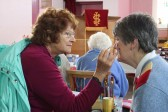 Jeanette Moser paints Rosemary Davis' face at the Coveney & Pymoor Methodist Chapels Spring Fayre held at the Pymoor Chapel,2011 .
