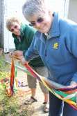 Cynthia Parson & Rosemary Davis preparing a Maypole for the Royal Wedding Celebrations in Pymoor 2011.