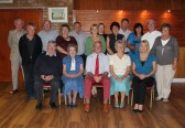 The Feofees & the Pymoor Cricket & Social Club Committees pose for a photograph at a 'Cheese & Wine' evening to celebrate the laying of the new floor, 2011.