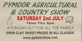 A board advertising the Pymoor Agricultural & Country Show taking place on Saturday 2nd July 2011. A great day out for all the family!