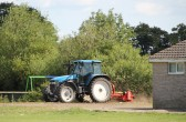 Parish Councillor Basil Taylor used his tractor to tidy up the area around the children's play area at the Pymoor Cricket Club, Pymoor Lane, Pymoor, 2011.