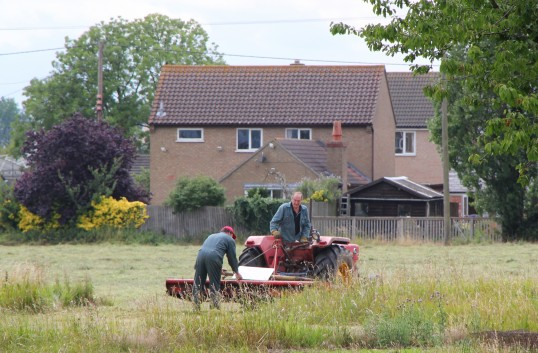 John & Graham Lark helping to prepare Graham's field off Pymoor Lane for the Pymoor Agricultural & Country Show.