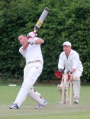"""""""Oh No! Not the window""""! Pymoor CC Wicketkeeper, Jack Hargraves, watches the Little Downham batsman hit another 6 in the Kirkland Cup Match in Pymoor 2011."""