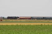 A steam train crossing the fens near Main Drove, Pymoor.
