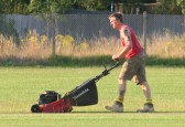 Nicholas Saberton cutting the cricket square in readiness for Pymoor CC's next home match on the Sports field in Pymoor Lane, Pymoor, 2011.