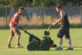 Brothers Nicholas & Steve Saberton cutting the cricket square in readiness for Pymoor CC's next home match on the Sports field in Pymoor Lane, Pymoor, 2011.