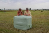 Cynthia Parson & Rosemary Davis by a hay bale in Graham Lark's field off Pymoor lane, Pymoor.