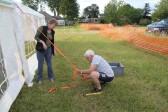 Liz Finch & Alan Butcher putting up the Pymoor Social Club tent in Graham Lark's field, off Pymoor Lane, in readiness for the Pymoor Show 2011